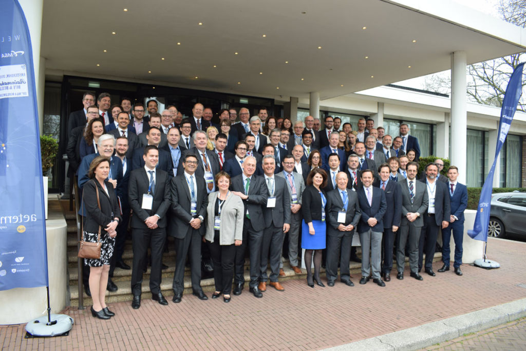 Members of M&A Worldwide in Amsterdam on steps in front of conference centre