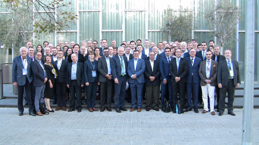 Members of M&A Worldwide in Barcelona on steps in front of conference centre