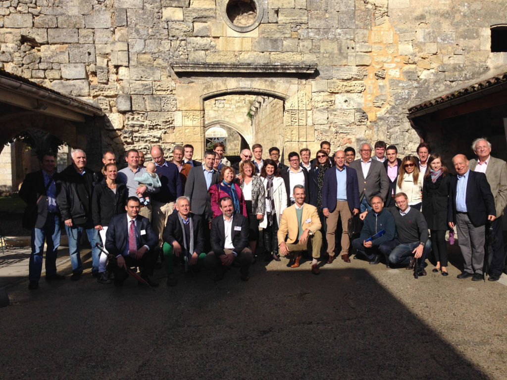 Members of M&A Worldwide in Bordeaux in front of a winery on tour